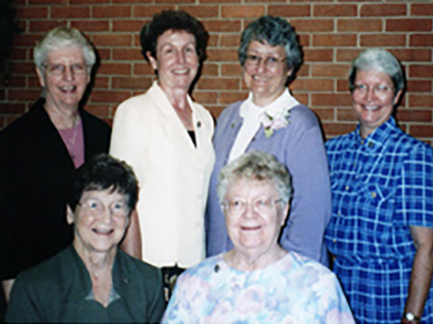 Back (L to R): Sisters Doris Jean Grewe, Carol Reeb, Glenda Becker, Judy Ann Obermark. Front (L to R): Sisters Frances Ann Eveler and Catherine DeWitt.