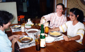 Sister Charlene Fill enjoying a meal with <br />friends in Paraguay.
