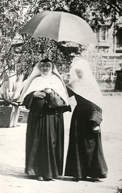 Mother Caroline Friess (at left) walking with a novice at the Milwaukee Motherhouse, circa 1891.