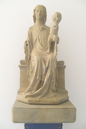 "The ""Angermadonna"" depicts Jesus sitting on Mary's lap. The sculpture was made of sandstone (freestone) in the Rhineland Palatine about the year 1340. This copy is in the Anger cloister (the Munich Motherhouse is located on ""Anger."") The original is in th"