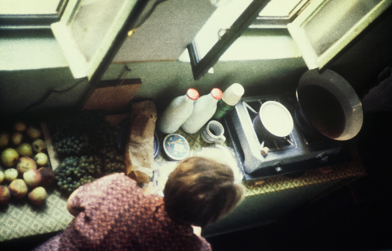 Preparing a meal on a hotplate in the stairwell.