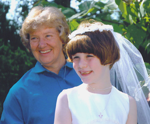 Rita Schonhoff is active in her parish and is shown with a first communicant whose parents have supported her ministry.