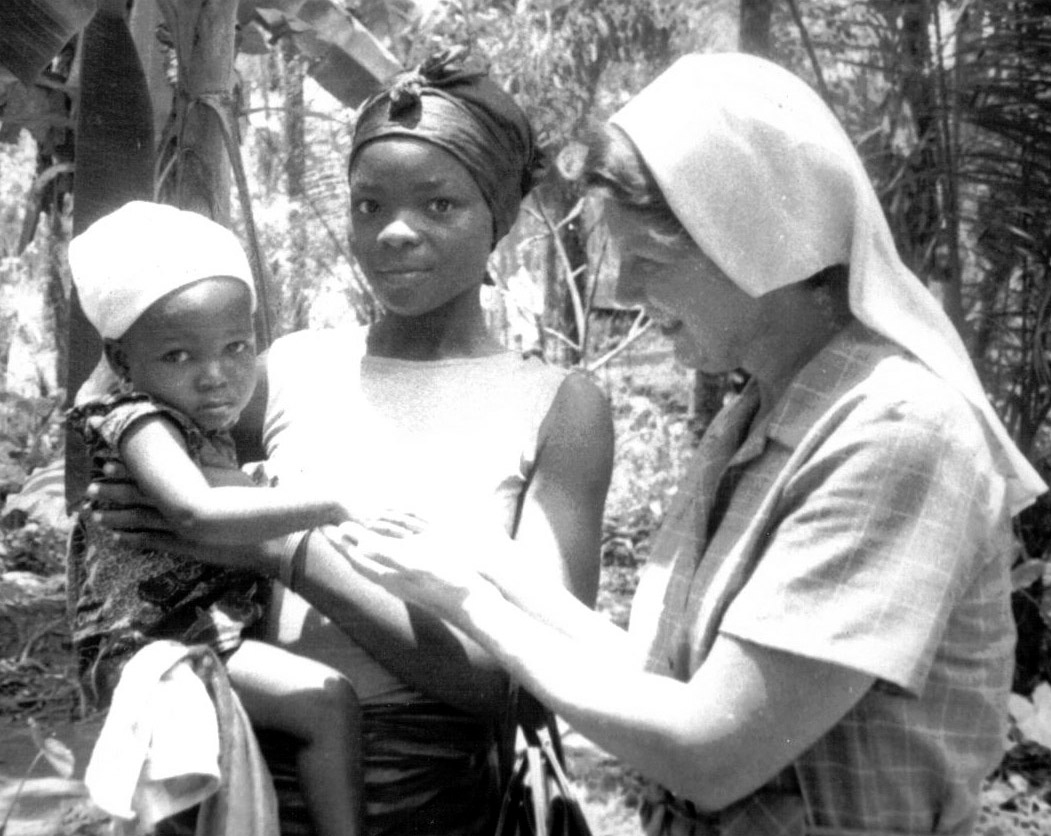 Sister Melmarie Gentry is greeting a mother and child in Nigeria in 1974.