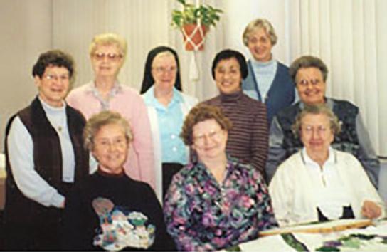 The Liturgical Fabric Arts Dept. (row 1, l to r) Sisters Mary Ann Giese, Rita Maureen Deimeke, Henriette Hoene, (second row, l to r) Frances Ann Eveler, LaVerne Kleinheider, Marie Virginia Strubhart, Regina Kabayama, Josephine Niemann, and Mary Avila Markiewicz