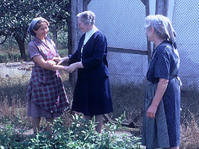 Mother Georgianne greeting Sisters at the chicken farm in Romania.