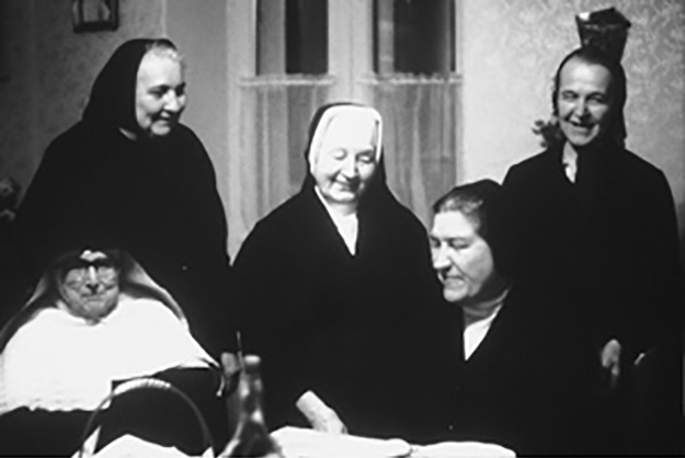 Sister Amabilis (seated at right) visits with Sisters living under communism.