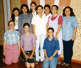 S. Charlene Fill, SSND (lower left), and Sister Reina del Carmen (standing, second from right) with young women in Paraguay who are interested in SSND.