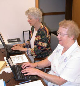 Sister Sue VonBank, SSND and Sister Gabriel Mary Spaeth, SSND record assessment data for the Nun Study. height=