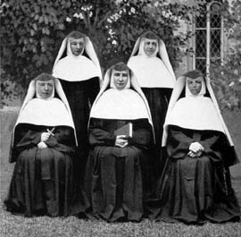 According to S. Rosella Kneice (ML) who worked in the printery in Milwaukee in the 1920's, Rev. Mother M. Stanislaus Kostka, Commissary General, didn't like the way the habits looked on the five pioneers in their original group photo. She had five sisters, Crispin Linse, Agnes Hoffman, F. DeChantal Oswald, Aluine Hoerres, and Mary Xavier Baggeler, dress in their best (1920's starched veils and folded wimples) to pose for a picture as closely matched in position as possible. Then the faces of the pioneers were cut from the real picture and superimposed on the 1920's figures. These sisters had to take an oath of secrecy. S. M. Rosella cannot identify the face put on the person in the Mother Caroline position. Was that perhaps taken from Caroline's passport, or is that another person?The pioneers were, from left to right, as follows: Front row: Mother Seraphine, Mother Caroline, Sister Emmanuel, Mistress of Novices. Back row: Mother Theophila, Sister Seraphica. (From Mother Caroline and the School Sisters of Notre Dame by Sister Dymphna Flynn, 1928).