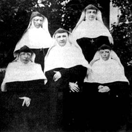 The original picture of the five pioneer sisters. The pioneers were, from left to right, as follows: Front row: Mother Seraphine, Mother Caroline, Sister Emmanuel, Mistress of Novices. Back row: Mother Theophila, Sister Seraphica. (From Mother Caroline and the School Sisters of Notre Dame by Sister Dymphna Flynn, 1928).
